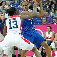 11 August 2012: France Sandrine Gruda looks to pass the ball over Sylvia Fowles during 86-50 Team USA victory over Team France, during the Women's Gold Medal Game, at the North Greenwich Arena, in London, Great Britain.