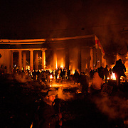 January 24, 2014 - Kiev, Ukraine: Protestors stand guard near burning tires at a defensive barricade near Dynamo Kiev's stadium in central Kiev. (Paulo Nunes dos Santos)