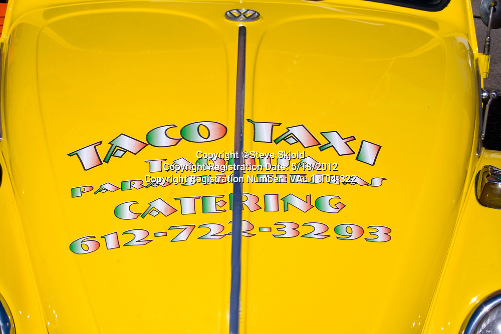 Yellow Taco Taxi Mexican Restaurant and Catering delivery car in parade. Mexican Independence Day Minneapolis Minnesota MN USA
