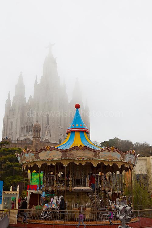 Clouds envelope the amusement park and basilica at Tibidabo, Barcelona.