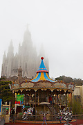 Clouds envelope the amusement park and basilica at Tibidabo, Barcelona.