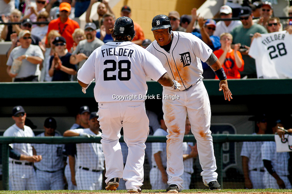 March 14, 2012; Lakeland, FL, USA; Detroit Tigers first baseman Prince Fielder (28) celebrates with third baseman Miguel Cabrera (24) following a two run homerun against the New York Mets during a spring training game against the New York Mets at Joker Marchant Stadium. Mandatory Credit: Derick E. Hingle-US PRESSWIRE