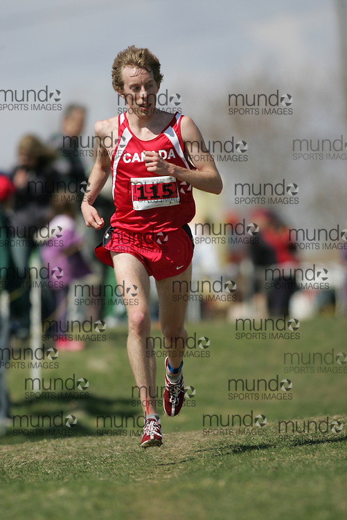 (Kingston, Canada---11 April 2010) Matthew Brunsting (#115) of Canada (CAN) runs in the \men's 10km race\ at the 17th World University Cross Country Championships (FISU) held on the Fort Henry Hill course in Kingston, Ontario, Canada. This photograph is Copyright Sean Burges / Mundo Sport Images, 2010. For information, go to www.mundosportimages.com or contact info@mundosportimages.com.