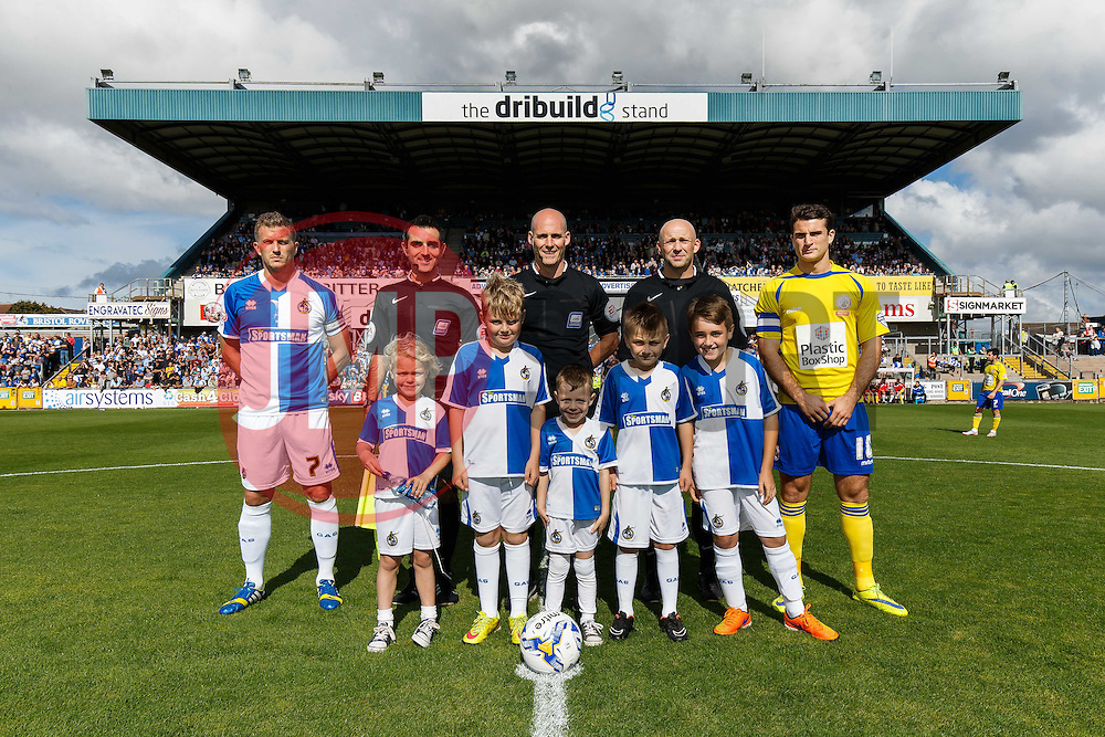 The mascots pose before kick off with Captains Lee Mansell of Bristol Rovers and Terry Gornell of Accrington Stanley and referee Kevin Johnson with his assistants  - Mandatory byline: Rogan Thomson/JMP - 07966 386802 - 12/09/2015 - FOOTBALL - Memorial Stadium - Bristol, England - Bristol Rovers v Accrington Stanley - Sky Bet League 2.