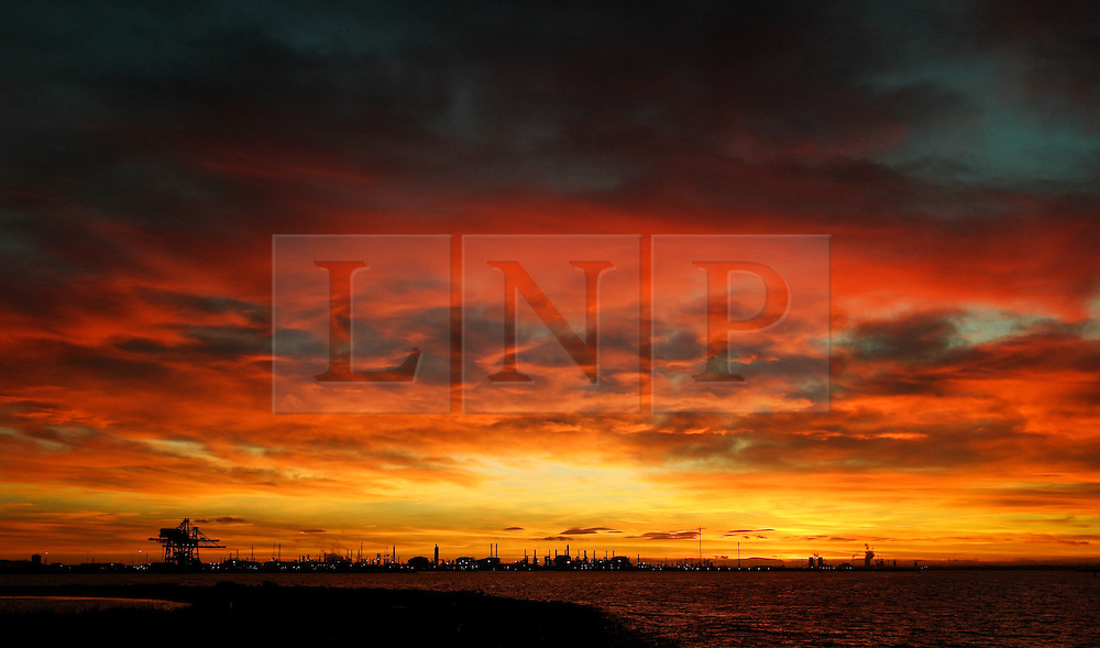 © Licensed to London News Pictures. <br /> 30/11/2016. <br /> REDCAR, UK.  <br /> A striking sunset above the industry of Teesside on the last day of Autumn.<br /> Photo credit: Ian Forsyth/LNP