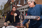 Manska Intan Sari, left, and Airlangga Dermawan work the grill for the Indonesian Students Association table at the International Street Fair on Saturday, April 18, 2015.  Photo by Ohio University  /  Rob Hardin