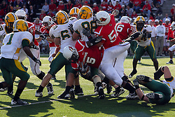 16 October 2010: Ashton Leggett attempts to get another yard by flying backwards into the pile during a game where the North Dakota State Bison lost to the Illinois State Redbirds 34-24, meeting at Hancock Stadium on the campus of Illinois State University in Normal Illinois.