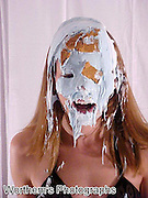 This pretty model gets her first taste of what slapstick is by taking a nice big pie in the face.