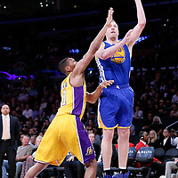 11 April 2014: Golden State Warriors forward David Lee (10) goes for the skyhook over Los Angeles Lakers forward Wesley Johnson (11) during the Golden State Warriors 112-95 victory over the Los Angeles Lakers at the Staples Center, Los Angeles, California, USA.