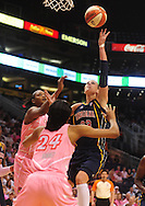 Aug 8, 2010; Phoenix, AZ, USA; Indiana Fever guard Katie Douglas puts up a basket against Phoenix Mercury Forward DeWanna Bonner during the first half at US Airways Center.  Mandatory Credit: Jennifer Stewart-US PRESSWIRE