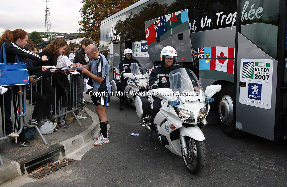 The police escort sets up while Brendon Leonard signs autographs. All Blacks in Aix en Provence, Rugby World Cup, 26 September 2007.