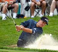 Phil Mickelson of the US chips from a trap on the twelveth hole during the first day of the US Open Golf Championship at Winged Foot Golf Club in Mamaroneck, New York Thursday, 15 June 2006.