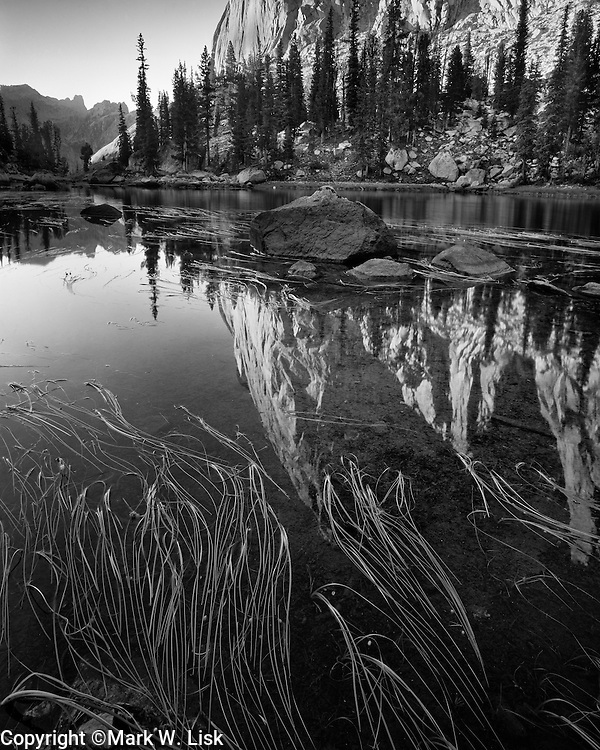 The famous Elephants Perch reflects into Saddle Back Lake high in the Sawtooth National Forest.