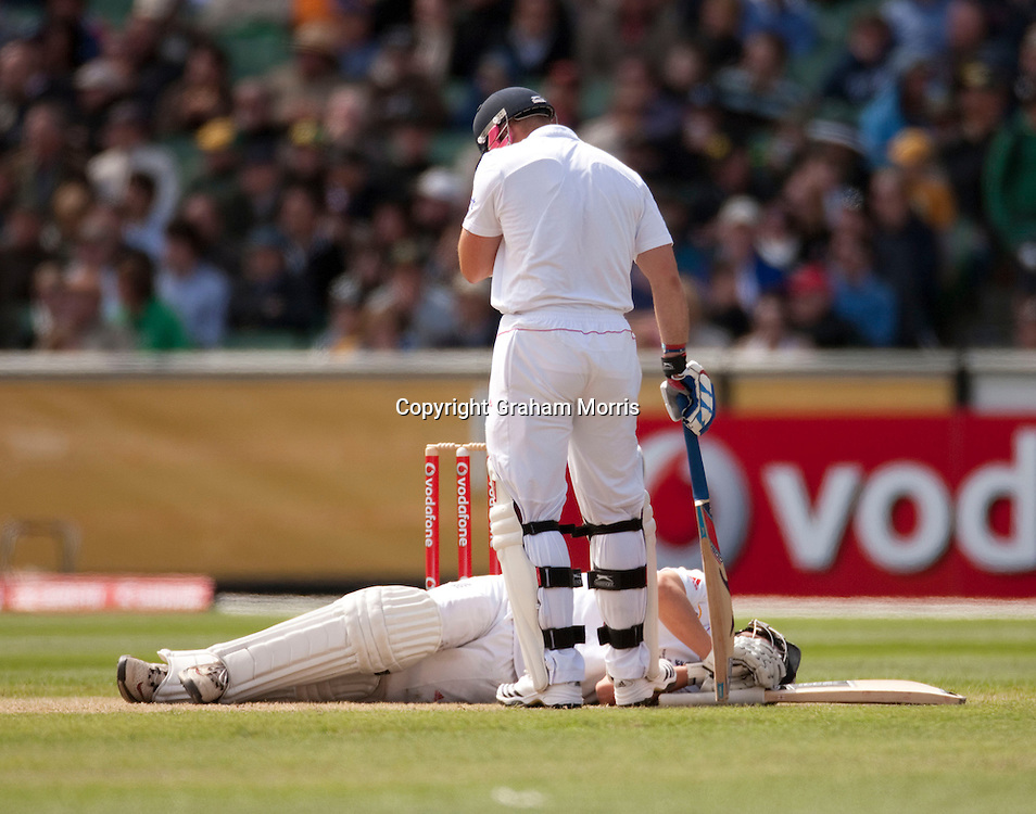 Jonathan Trott down after being hit on the leg during the fourth Ashes test match between Australia and England at the MCG in Melbourne, Australia. Photo: Graham Morris (Tel: +44(0)20 8969 4192 Email: sales@cricketpix.com) 27/12/10