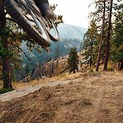 Rex Flake gets air on early morning singletrack near Leavenworth, Washington.