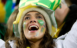 Football - soccer: FIFA World Cup South Africa 2010, Brazil (BRA) - Korea DPR (PRK), A Brazil fan enjoys the atmosphere ahead of the 2010 FIFA World Cup South Africa Group G match between Brazil and North Korea at Ellis Park Stadium on June 15, 2010 in Johannesburg, South Africa.