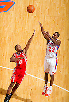 The New York Knicks' Toney Douglas shoots over the Houston Rockets' Ishmael Smith at Madison Square Garden.