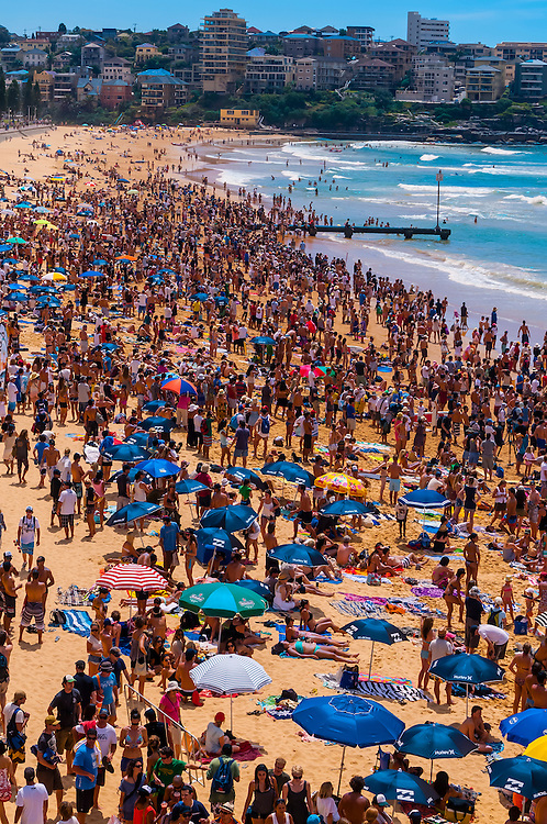 A large crowd on the beach during the Australian Open of Surfing at Manly Beach, Sydney, New South Wales, Australia