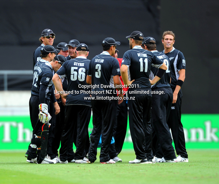 The Black Caps huddle after the dismissal of Kamzan Akmal off the bowling of Tim Southee (right). First one-day international cricket match - New Zealand v Pakistan at Westpac Stadium, Wellington, New Zealand on Saturday, 22 January 2011. Photo: Dave Lintott / photosport.co.nz
