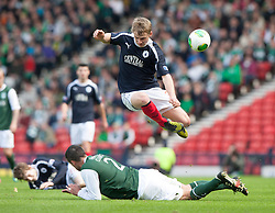 Falkirk's Stephen Kingsley over Hibernian's Tim Clancy..Hibernian 4 v 3 Falkirk, William Hill Scottish Cup Semi Final, Hampden Park..©Michael Schofield..