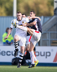 Dumbarton's Andy Graham and Falkirk's David McCracken.<br /> Falkirk 1v 1 Dumbarton, Scottish Championship game played 20/9/2014 at The Falkirk Stadium .