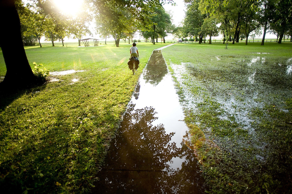 Alexis Erkert rides through a flooded park. Twin Lakes State Park, Calhoun County, Iowa, 8/22/2007 Photo by Ben Depp