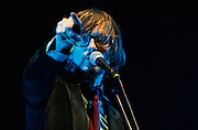 Jarvis Cocker of Pulp performs live on the Main Stage during day two of Reading Festival 2011 on August 27, 2011 in Reading, England.  (Photo by Simone Joyner)