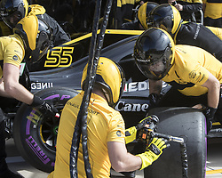 October 21, 2018 - Austin, USA - Members of the Renault Sport team change tires on Renault Sport driver Carlos Sainz's car before the start of the Formula 1 U.S. Grand Prix at the Circuit of the Americas in Austin, Texas on Sunday, Oct. 21, 2018. (Credit Image: © Scott Coleman/ZUMA Wire)