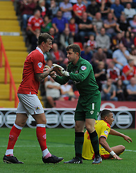 Bristol City Goalkeeper, Frank Fielding gets congratulated by Bristol City's Aden Flint after making a crucial save. - Photo mandatory by-line: Nizaam Jones- Mobile: 07583 3878221 - 27/09/2014 - SPORT - Football - Bristol - Ashton Gate - Bristol City v MK Dons - Sports