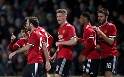 Manchester United's Alexis Sanchez (left) speaks with team-mates after Manchester United's Marcus Rashford (second right) scores his side's first goal of the game during the Emirates FA Cup, fourth round match at Huish Park, Yeovil.