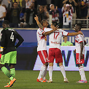 Tim Cahill, New York Red Bulls, celebrates with team mates after scoring his sides fourth goal during the New York Red Bulls Vs Seattle Sounders, Major League Soccer regular season match at Red Bull Arena, Harrison, New Jersey. USA. 20th September 2014. Photo Tim Clayton
