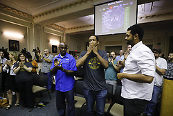 August 17, 2017 - Lexington, KY, USA - DeBraun Thomas, of Lexington, Ky., center, with the group Take Back Cheapside, reacts after the Lexington-Fayette Urban County Council unanimously voted on Thursday, Aug. 17, 2017 to move two Confederate-era statues from downtown Lexington at the Lexington-Fayette Urban County Government Center in Lexington, Ky. (Credit Image: © Alex Slitz/TNS via ZUMA Wire)