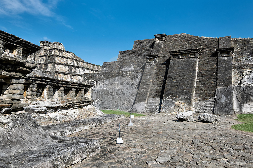 Mesoamerica Blue Temple Pyramid, right, at the  pre-Columbian archeological complex of El Tajin in Tajin, Veracruz, Mexico. El Tajín flourished from 600 to 1200 CE and during this time numerous temples, palaces, ballcourts, and pyramids were built by the Totonac people and is one of the largest and most important cities of the Classic era of Mesoamerica.