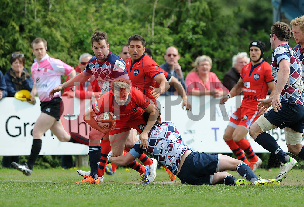 Bristol Rugby Scrum-Half Dwayne Peel (capt) is tackled by Rotherham Titans replacement Dan White - Photo mandatory by-line: Dougie Allward/JMP - Mobile: 07966 386802 - 10/05/2015 - SPORT - Rugby - Sheffield - Abbeydale Dale Sports - Rotherham Titans v Bristol Rugby - Greene King IPA Championship