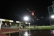 STELLENBOSCH, SOUTH AFRICA, Tuesday 20 March 2012, Jacob Araptany of Uganda hurdles the water jump in the mens 3000m steeplechase during the Yellow Pages Series athletics meeting at the University of Stellenbosch Coetzenburg stadium..Photo by Roger Sedres/Image SA