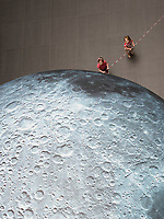 17/07/2018 repro free:  Holly and Sadie Leonard  at Luke Jerram&rsquo;s Museum of the Moon measuring seven metres in diameter and featuring 120dpi detailed NASA imagery of the lunar surface pictured in  Human Biology Building, NUI Galway as part of Galway International Arts Festival. Museum of the Moon is a new touring artwork by UK artist Luke Jerram who is known worldwide for his large scale public artworks.  The installation is a fusion of lunar imagery, moonlight and surround sound composition created by BAFTA and Ivor Novello award winning composer Dan Jones. GIAF runs from 16 &ndash; 29 July www.giaf.ie<br />   .Photo:Andrew Downes, XPOSURE
