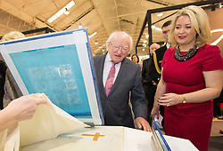 Repro Free: 18/01/2015<br /> Pictured at the opening of Showcase 2015, Ireland&rsquo;s largest international trade fair is President of Ireland Michael D. Higgins with Chief Executive of the Design and Crafts Council of Ireland, Karen Hennessy as they get a Silk Screen Printing demonstration. Showcase runs in the RDS until Wednesday, 21st January.  Picture Andres Poveda<br /> <br /> For more information visit <br /> www.showcaseireland.com.