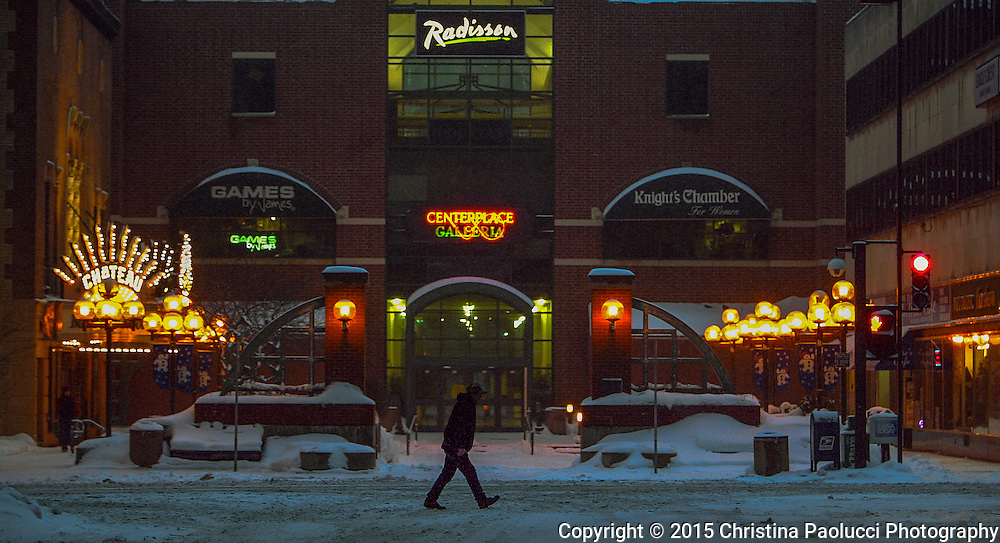 A lone walker passing Peace Plaza in downtown Rochester Thursday evening after rush hour left traffic was long past. (Rochester Post-Bulletin, Christina Paolucci)
