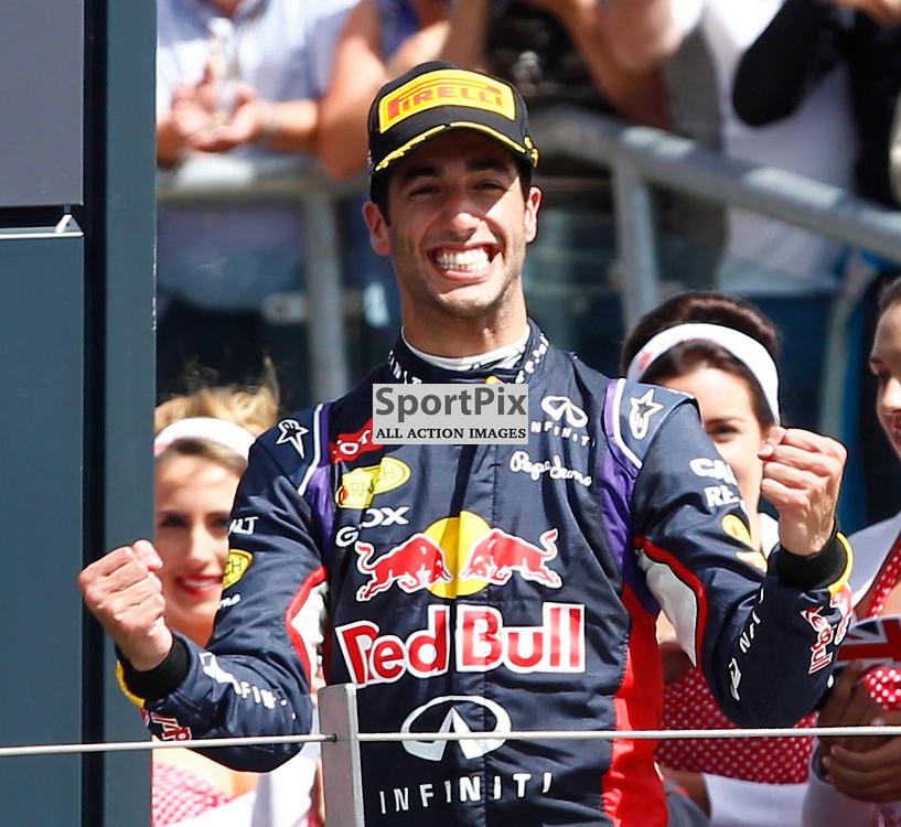 FORMULA 1 SANTANDER BRITISH GRAND PRIX .. Daniel Ricciardo celebrates his third place in the British GP...(c) STEPHEN LAWSON | SportPix.org.uk