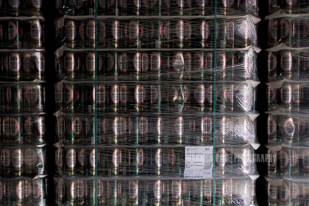 Pallets of empty cans of Murree Classic Larger wait to be filled at the Murree Brewery, December 21, 2006, Rawalpindi, Pakistan. The brewery boasts the first 20 year-old malt whiskey in the Muslim world, due for release in mid-2007. Established more than a century ago under British Raj, Murree Brewery also is Pakistan's oldest company and one of two breweries in a country under prohibition. Muslims have been banned from drinking alcohol since it was outlawed in 1977, but Christians and Hindus may still buy alcohol. The brewery hopes to export the exclusive whiskey to Europe and the Middle East. (Photo by Warrick Page)