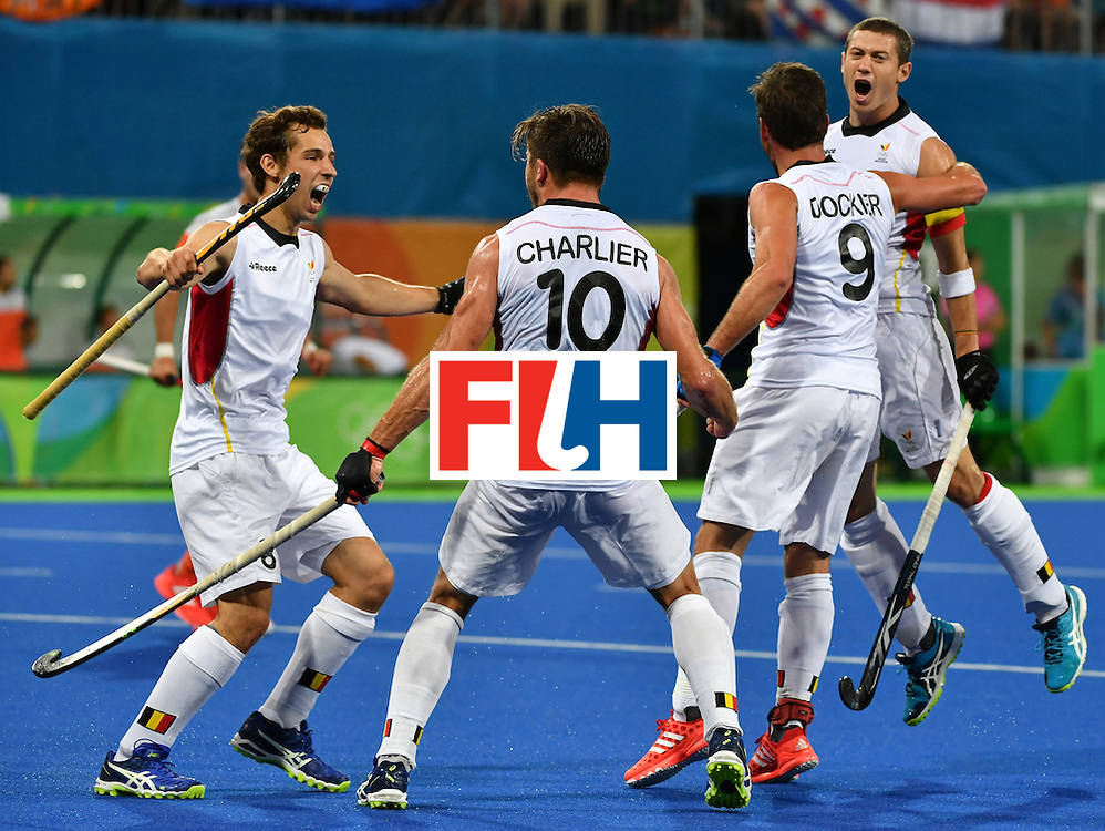 Belgium's John John Dohmen (R) celebrates a goal with teammates during the men's semifinal field hockey Belgium vs Netherlands match of the Rio 2016 Olympics Games at the Olympic Hockey Centre in Rio de Janeiro on August 16, 2016.  / AFP / Pascal GUYOT        (Photo credit should read PASCAL GUYOT/AFP/Getty Images)