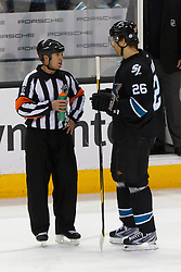 Feb 10, 2012; San Jose, CA, USA; San Jose Sharks center Michal Handzus (26) talks with NHL referee Brian Pochmara (16) during a stoppage in play against the Chicago Blackhawks during the first period at HP Pavilion. San Jose defeated Chicago 5-3. Mandatory Credit: Jason O. Watson-US PRESSWIRE