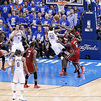 12 June 2012: Oklahoma City Thunder small forward Kevin Durant (35) is fouled as he goes to the basket during the Oklahoma City Thunder 105-94 victory over the Miami Heat, in Game 1 of the 2012 NBA Finals, at the Chesapeake Energy Arena, Oklahoma City, Oklahoma, USA.