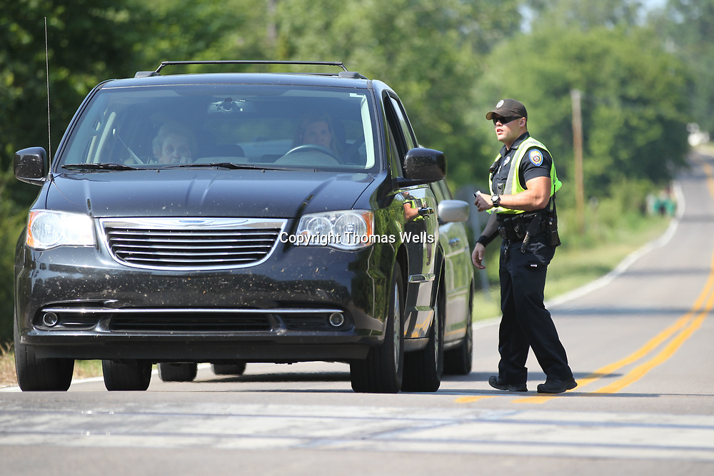 Tupelo Police Officer Mitchell Cunningham makes sure drivers have a valid drivers license and car tag during a safety checkpoint on Lumpkin Street.