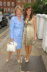 Left to right, KATHRYN APANOWICZ partner of the late Richard Whiteley and CAROL VORDERMAN at Sir David & Lady Carina Frost's annual summer party held in Carlyle Square, Chelsea, London on 5th July 2006.<br /><br />NON EXCLUSIVE - WORLD RIGHTS