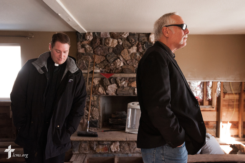 The Rev. Paul Rhode of Eternal Savior Lutheran Church (right) and the Rev. Michael W. Meyer, manager of LCMS Disaster Response (left), survey a flood-damaged home in Lyons, Colo., on Wednesday, Jan. 8, 2014. LCMS Communications/Erik M. Lunsford