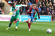 Plymouth Argyll midfielder Graham Carey (10) and Scunthorpe United forward George Thomas (18) battle for possession  during the EFL Sky Bet League 1 match between Scunthorpe United and Plymouth Argyle at Glanford Park, Scunthorpe, England on 27 October 2018. Pic Mick Atkins