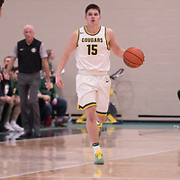 1st year guard Brayden Kuski (15) of the Regina Cougars in action during the home opener on November  10 at Centre for Kinesiology, Health and Sport. Credit: Arthur Ward/Arthur Images