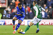 Alfredo Morelos under pressure from Mark Milligan during the Ladbrokes Scottish Premiership match between Hibernian and Rangers at Easter Road, Edinburgh, Scotland on 8 March 2019.
