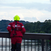 Firefighters line the bridges in Perth joining an RAF Search & Rescue Sea King Helicopter looking for a reported missing person in the River Tay....28.07.13<br /> Picture by Graeme Hart.<br /> Copyright Perthshire Picture Agency<br /> Tel: 01738 623350  Mobile: 07990 594431